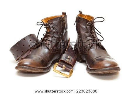 Fashionable men's leather shoes and leather belt with buckle isolated on white background - stock photo