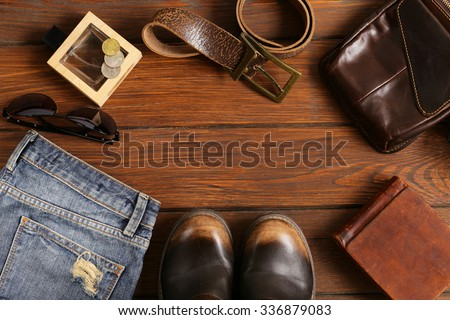 Fashionable men set on a wooden background
