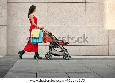 Fashionable modern mother on a city street