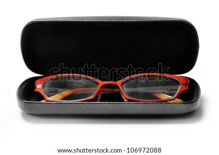 Fashionable orange glasses in a black box isolated on white background - stock photo