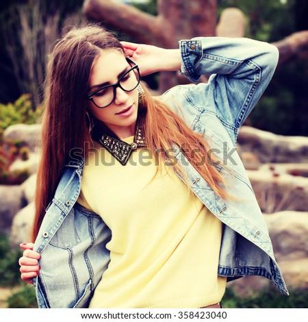 Fashionable portrait of a beautiful hipster girl. Denim stylish clothes. Glamorous Lady fashion trends. - stock photo