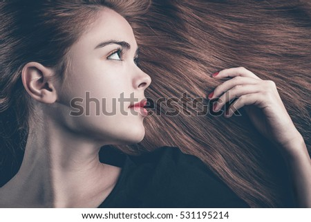 Fashionable portrait of a beautiful woman lying on her hair