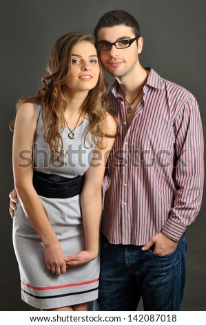 fashionable portrait of beautiful girl with long hair and boy. magnetic jewelry and beauty - stock photo