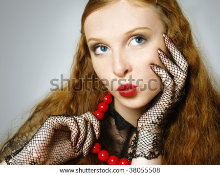 Fashionable portrait of the girl with red  beads