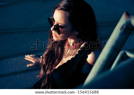 Fashionable portrait of woman in sunglasses. outdoors shot. - stock photo