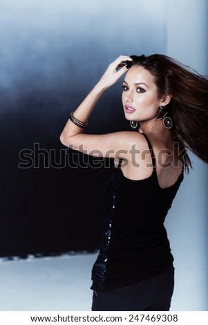 Fashionable portrait of woman posing - stock photo
