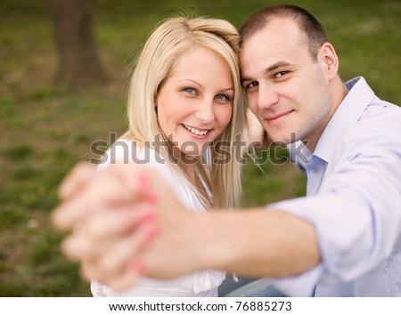 Fashionable romantic young couple outdoors in the park. - stock photo
