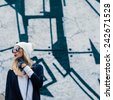 Fashionable sensual blonde on city street. Trendy urban Look. Cap and stylish Sunglasses. - stock photo