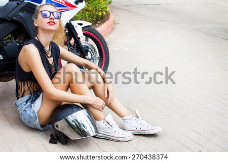 Fashionable sensual blonde on city street. Trendy urban Look. Motor style,cool and fashion ,wear motorcycle helmet and stylish Sunglasses. - stock photo