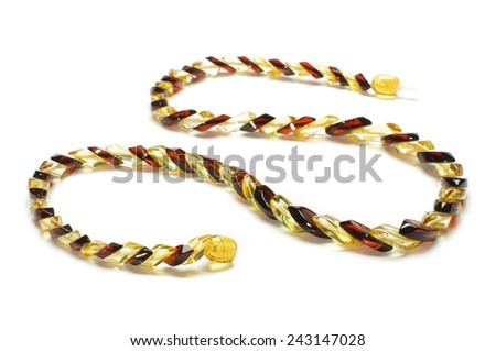 Fashionable snake type amber necklace isolated on the white background - stock photo