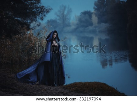 fashionable toning,creative computer colors,On the eve of Hello ween witch to conjure and decided to cook a potion in the tank, standing near the mystical  lake. - stock photo