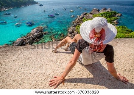 Fashionable tourist looking panorama from Sail Rock View Point of Kor 8 of Similan Islands National Park, Phang Nga, Thailand, one of the tourist attraction of the Andaman Sea. - stock photo