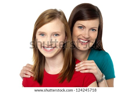 Fashionable trendy daughter and mom posing together in casuals. - stock photo
