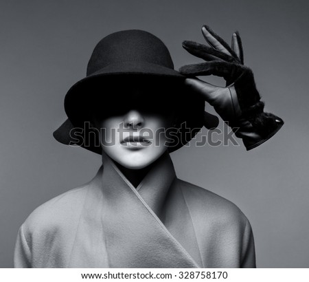 fashionable woman in a hat and a glove - stock photo
