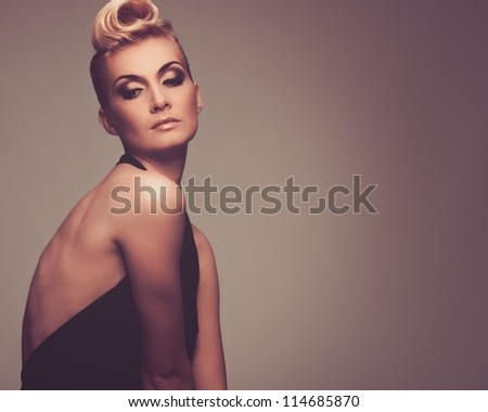 Fashionable woman in black with creative hairstyle - stock photo