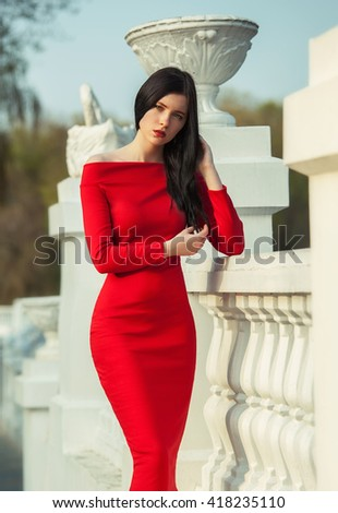 Fashionable woman in red dress - stock photo