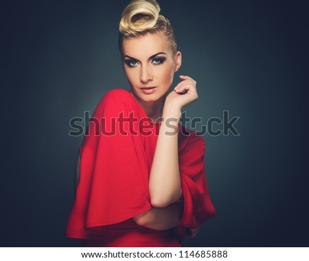 Fashionable woman in red with creative hairstyle - stock photo