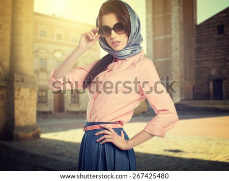 Fashionable woman on the streets of a small Italian town - stock photo