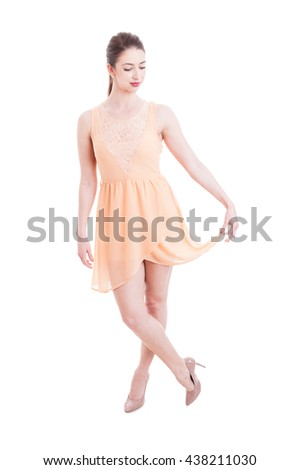 Fashionable woman posing in summer dress and high heels isolated on white background