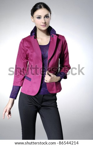 fashionable woman posing on light background - stock photo