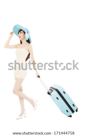 Fashionable woman running with suitcase - stock photo