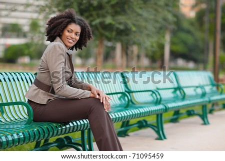 Fashionable woman sitting in the park