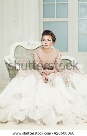 Fashionable Woman Sitting on Armchair - stock photo