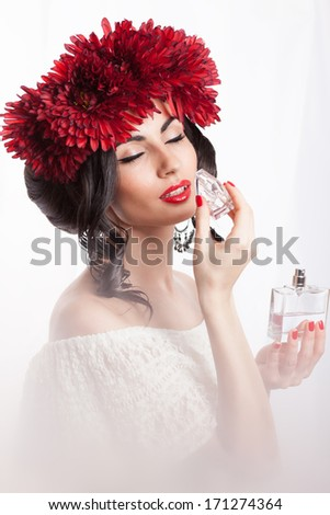 Fashionable woman sniffing a perfume - stock photo