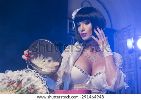 Fashionable woman with art visage - burlesque  - stock photo