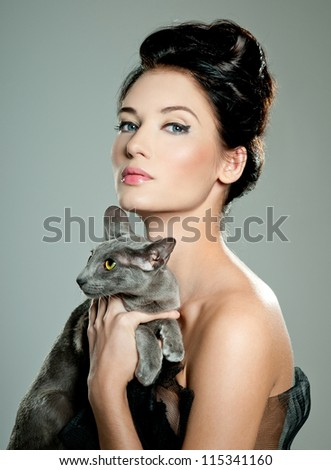fashionable woman with cat - stock photo