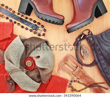 Fashionable women's clothing and accessories. Red-brown tone - stock photo