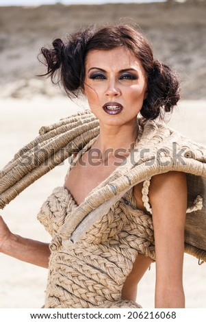 Fashionable young attractive and sensuality brunette woman in dress on the desert