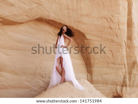 Fashionable young attractive and sensuality woman in the desert