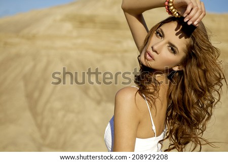 Fashionable young attractive and sensuality woman in the desert - stock photo