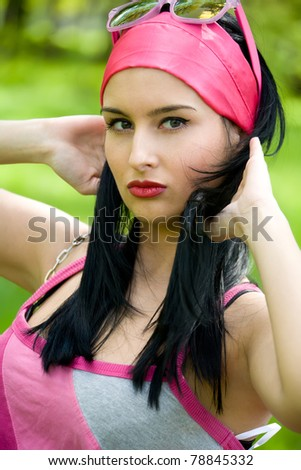 Fashionable young brunette outdoor portrait
