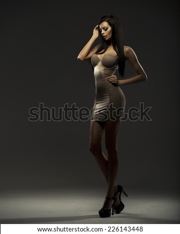 Fashionable young brunette sensual woman  - stock photo