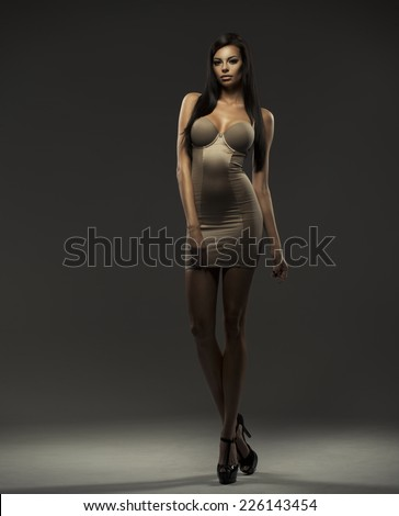 Fashionable young brunette sensual woman