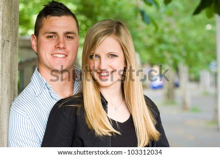 Fashionable young couple having fun outdoors.