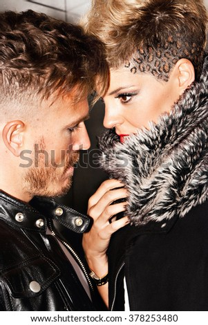 Fashionable young couple in love. Urban fashion photography. Vertical image.