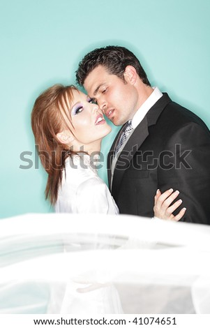Fashionable young couple on their wedding day - stock photo