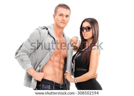 Fashionable young couple posing isolated on white background - stock photo