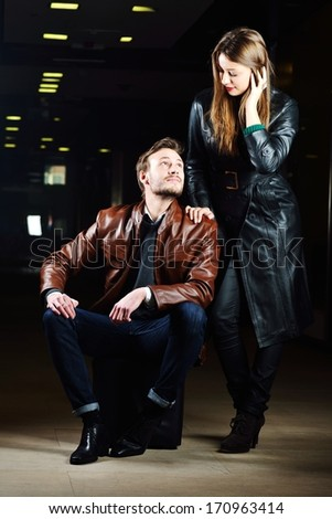 Fashionable young couple with leather clothes on