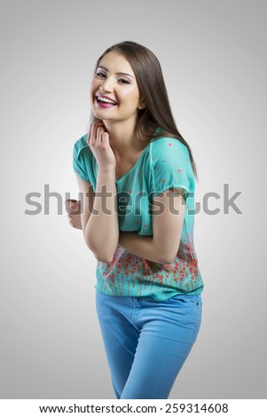 Fashionable young female smiling - stock photo