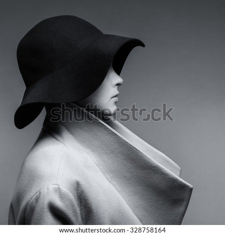 Fashionable young girl in a coat and hat - stock photo
