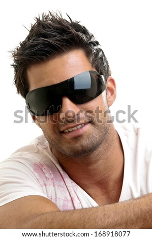 Fashionable young man with sun glasses isolated in white
