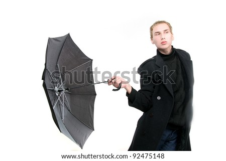 fashionable young man with umbrella over white - stock photo