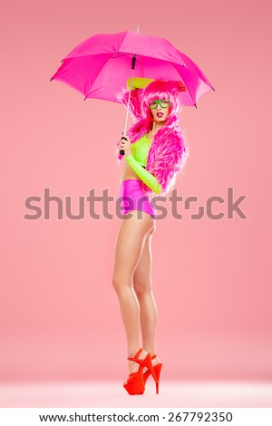 Fashionable young woman alluring in sexy vivid colourful clothes and high heels platform shoes. Bright fashion. Pin-up, pink style. Optics, eyewear. Full length portrait. - stock photo