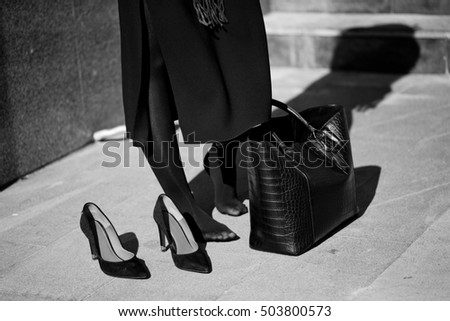 Fashionable young woman. Black and white concept.
