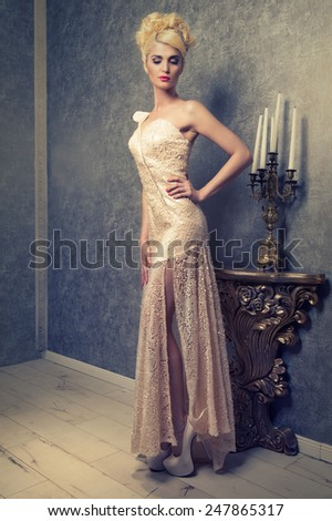 fashionable young woman in a long sequined dress