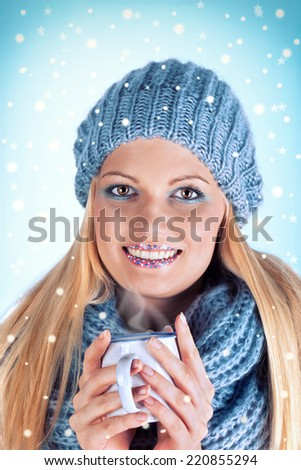 fashionable young woman in winter with a cup of hot tea